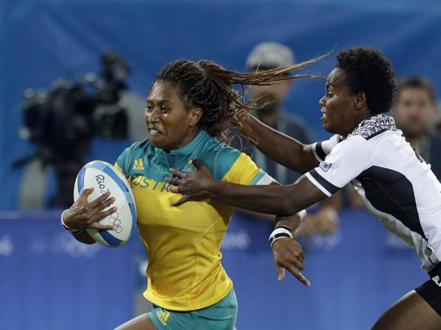 New Zealand players celebrate their victory in women's rugby sevens over Spain at the Deodoro Stadium in Rio on Saturday.