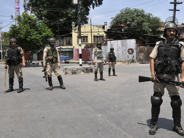 Soldiers stand guard during a curfew in Srinagar. More than 50 people have been killed and thousands injured in weeks of unrest in Kashmir, sparked by the death of militant commander Burhan Wani in a firefight with government forces.
