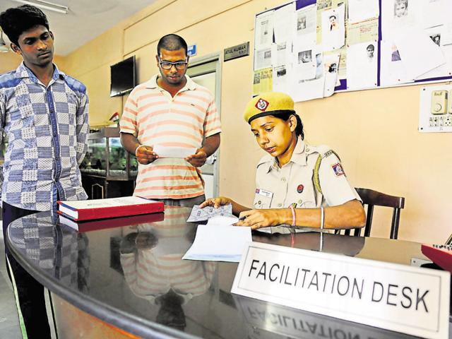 An officer attends to the grievance of a man at a public facilitation desk set up at Okhla Police Station on Friday.
