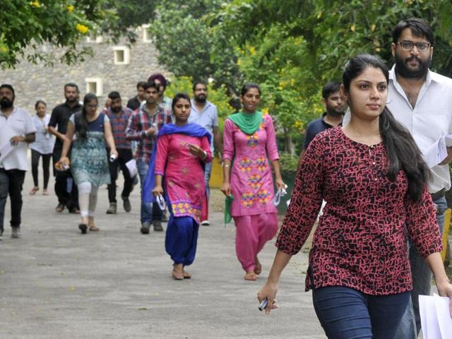 Candidates coming out after appearing in the UPSC preliminary exam at Government College for Girls in Ludhiana on Sunday.