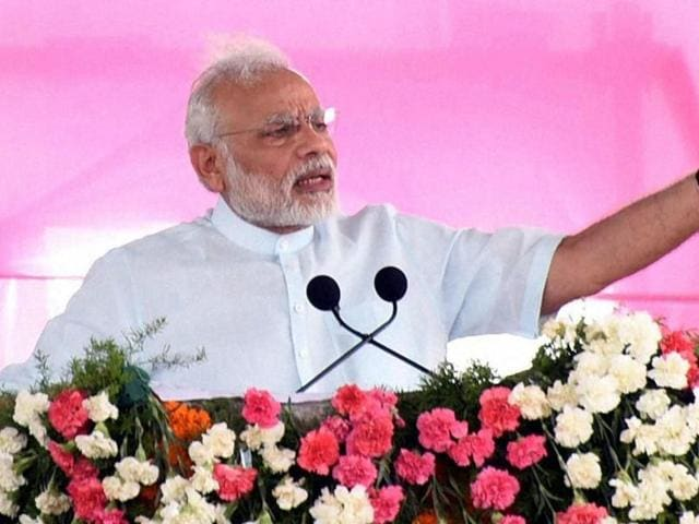 Prime Minister Narendra Modi addressing a public meeting at Gajwel, Medak District, in Telangana on Sunday.