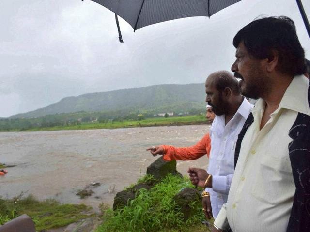 Minister of state for social justice and empowerment Ramdas Athawale visits the Mahad-Poladpur bridge which was washed away by the flood waters of Savitri river on Saturday.
