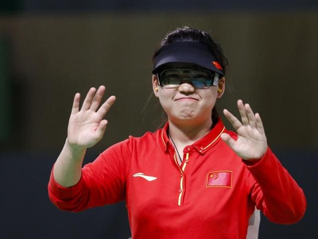 Zhang Mengxue of China celebrates winning the gold medal during the women's 10-meter air pistol event at the 2016 Summer Olympics in Rio de Janeiro.
