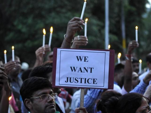 People take out a march demanding justice for the Bulandshahr gangrape victims, in Noida Saturday.