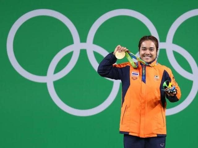 Sopita Tanasan of Thailand lifted 92kg in the snatch and 108kg in the clean and jerk for a total of 200kg win gold.