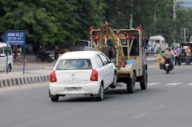 The rule is that vehicles parked at no parking zones be towed away to the nearest police station. The owner can take the vehicle only after submitting a fine of up to Rs 800. Part of the money goes to the traffic department and a larger portion to the MCG