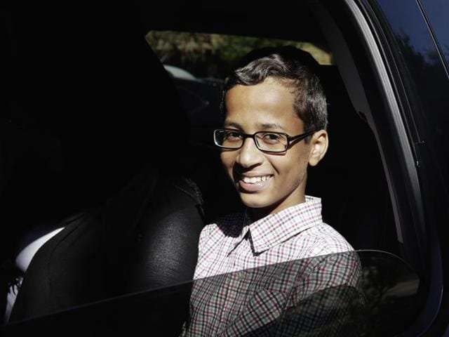 Ahmed Mohamed shows the clock he built in a school pencil box to reporters after a news conference in Dallas on Monday