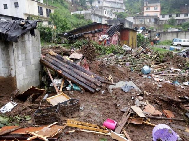 Damaged houses and debris after a mudslide caused by the passing of Tropical Storm Earl in Puebla state in Mexico.
