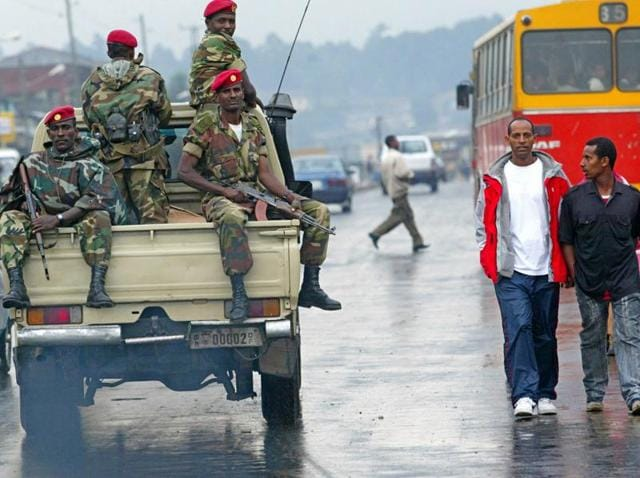 In this June 10, 2005 file photo, members of the Ethiopian army patrol the streets of Addis Ababa, Ethiopia, after recent clashes with protesters. Violent weekend clashes between protesters and security forces have claimed the lives of more than a dozen people across Ethiopia.