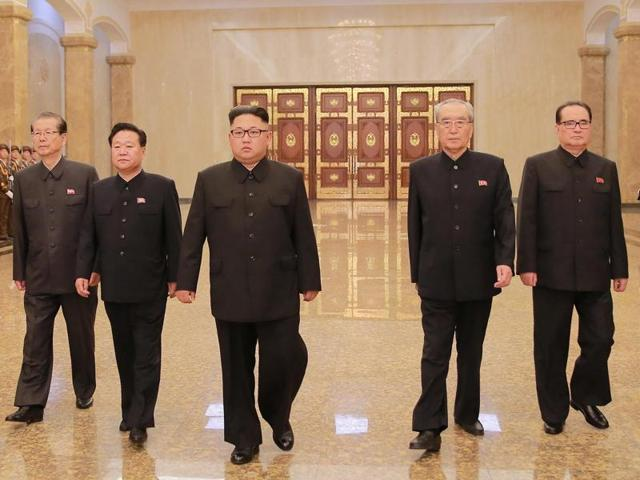North Korean leader Kim Jong Un (C) has taken a hands-off approach to the country's black market .