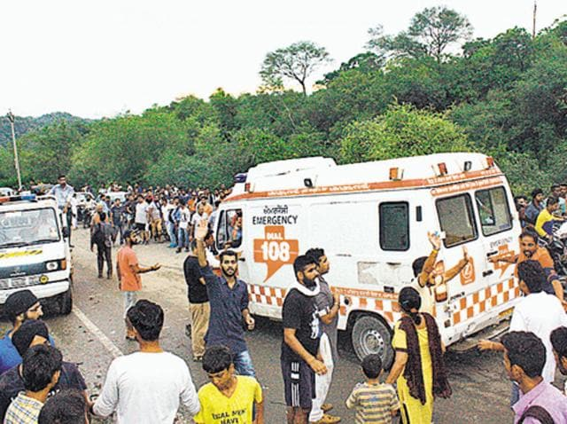 An ambulance at the spot where a group of pilgrims, who were on their way to Chintpurni temple, were crushed by a bus.