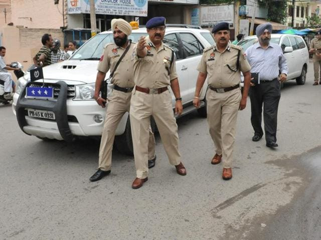 Commissioner of police Arpit Shukla and ADGP Hardeep Singh Dhillon inspecting the crime scene in Jalandhar on Sunday.