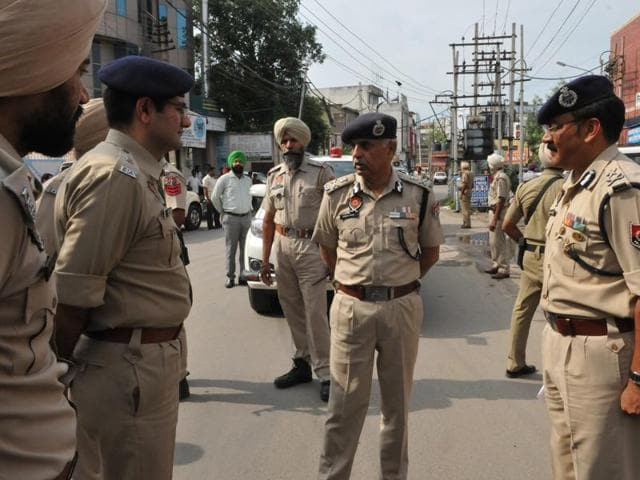 DGP Suresh Arora with police officials at the crime spot in Jalandhar on Sunday.