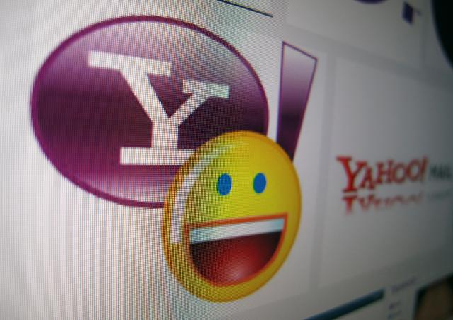 A Yahoo messenger logo is displayed on a monitor in this photo illustration shot April 16, 2013. REUTERS/Mike Blake/File Photo