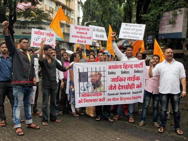 Protesters demand the arrest of Islamic preacher Zakir Naik in Mumbai.