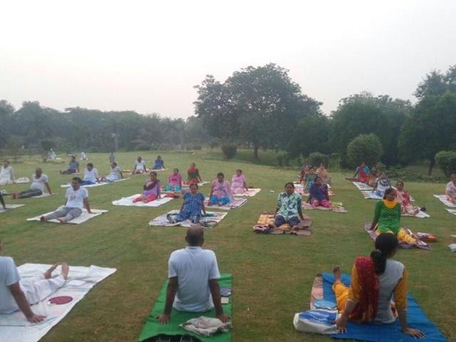 People perform yoga exercises at Ram Manohar Lohia park in Delhi.