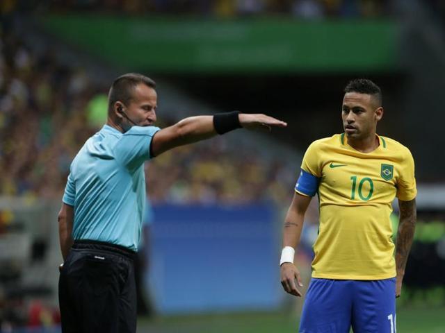 Neymar (yellow jersey) Neymar almost scored direct from a corner kick against Iraq.