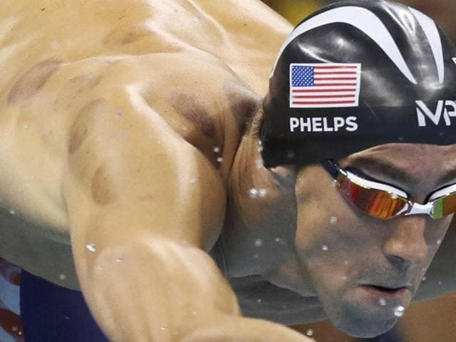 Michael Phelps of USA dives to start.