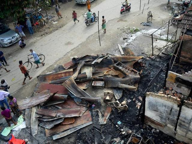 Debris of burnt shops after they were gutted in an attack by suspected Bodo militants at Balijan Tiniali market in Kokrajhar district of Assam on Saturday.