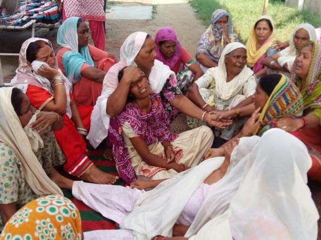 Family of the deceased mourning over their loss in Malko village on Tuesday.