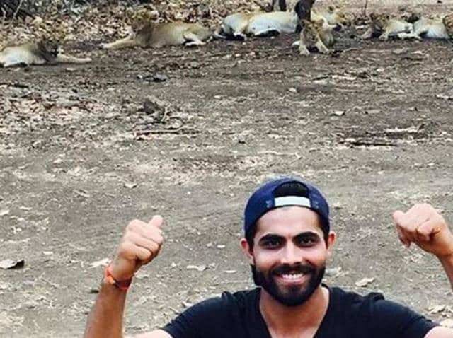 A photo shared by Jadeja on Instagram showed him  pointing at the lions in the background at Gir Wildlife Sanctuary at Sasan in Junagadh.