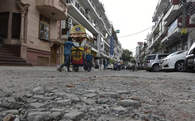 For more than a year, the approach road here has been broken and filled with potholes.