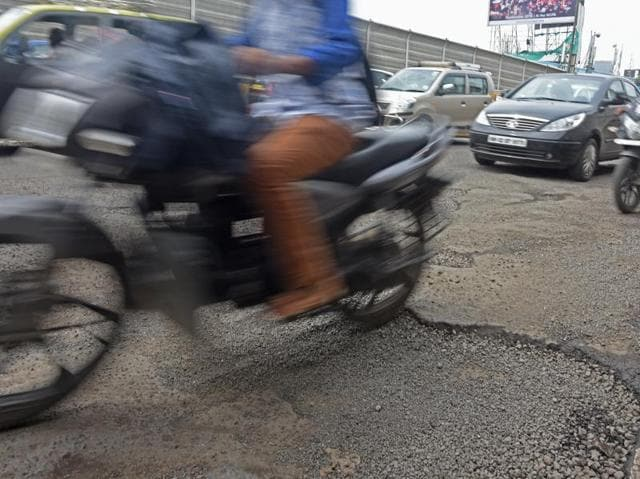 A large crater on the road near Bandra-Kurla Complex fixed using paver blocks, which is not the standard procedure.