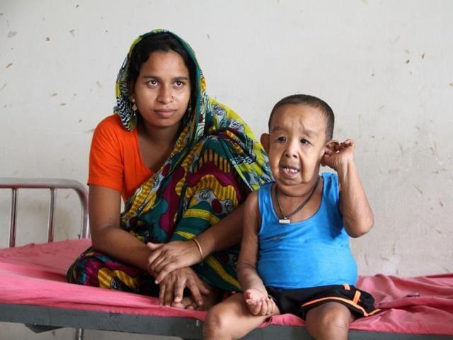 Bayezid Shikdar sits on a bed at Dhaka Medical College Hospital in Dhaka.  (AFP Photo)