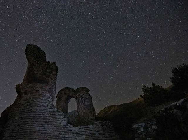 A Perseids meteor streaking across the night sky over the remains of St. Ilia Roman basilica near the town of Pirdop.