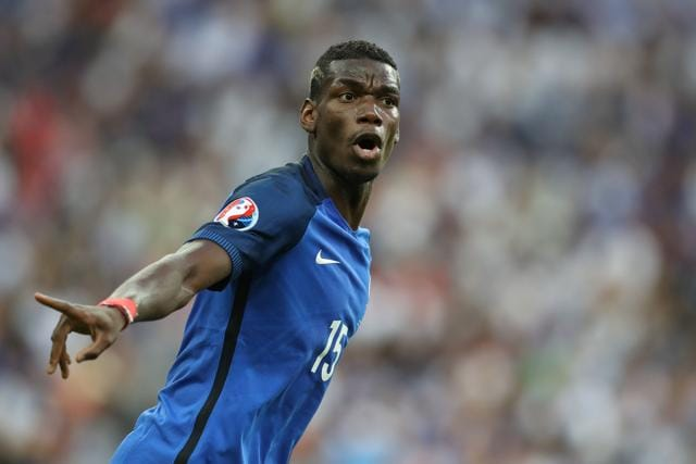 France's midfielder Paul Pogba gesturing during the Euro 2016 final football match between Portugal and France at the Stade de France.