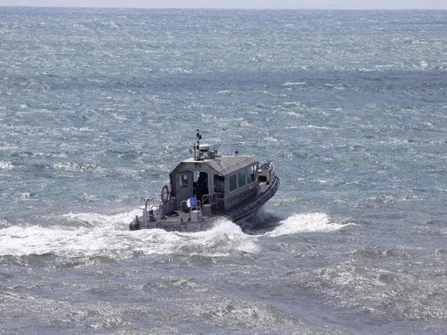 A patrol boat of the French maritime gendarmerie takes part in the search for wreckage from the missing MH370 plane off the coast of Saint-Marie on the French island of La Reunion.
