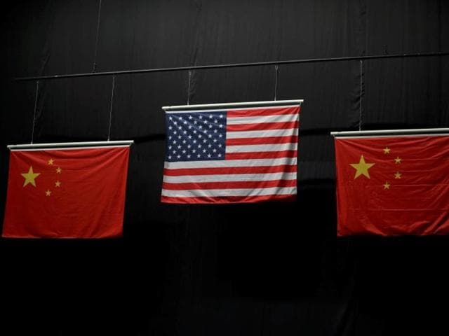 The Chinese flag has five stars in the top left hand corner -- a large one with four smaller ones to its right. The small stars are meant to circle and point to the main star but an inaccurate version used in shooting and swimming medal ceremonies had the little ones parallel to each other.