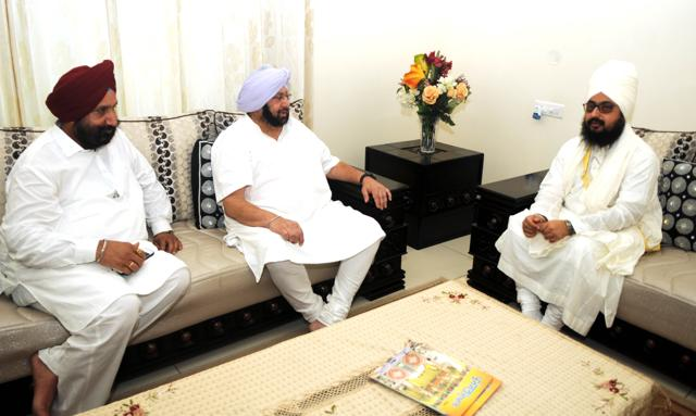 Accompanied by MLA Sukhjinder Singh Randhawa, Punjab Congress president Capt Amarinder Singh with Sikh preacher Ranjit Singh Dhadrianwala at the latter's sect headquarters, Gurdwara Parmeshwar Dwar, in Shekhupur village, 15 km from Patiala, on Tuesday.