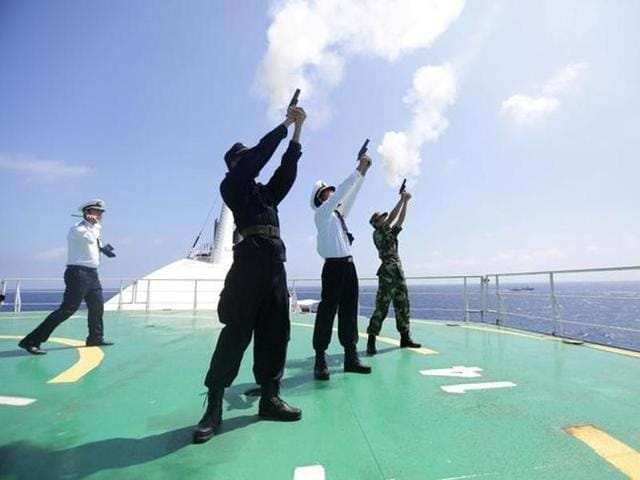 Soldiers of People's Liberation Army take part in a search and rescue exercise near Qilian Yu subgroup in the Paracel Islands, which is known in China as Xisha Islands, South China Sea, on July 14.(Reuters File)