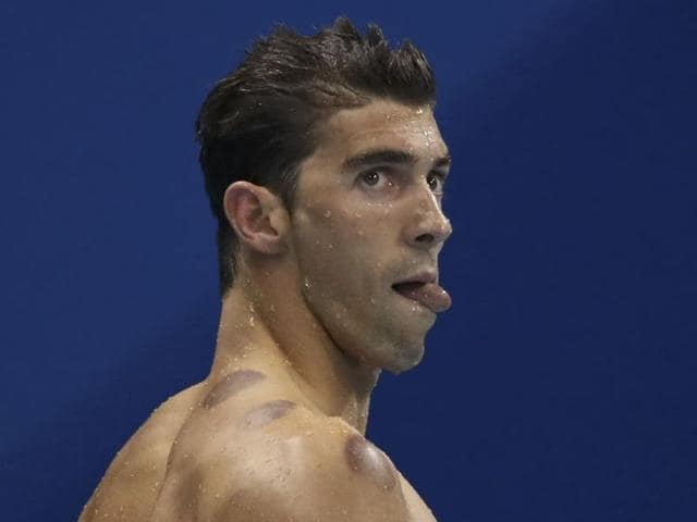 Michael Phelps (left) backed young teammate Lily King, who spoke out against dope-tainted Russian swimmer Yulia Efimova after winning the 100m breaststroke gold.