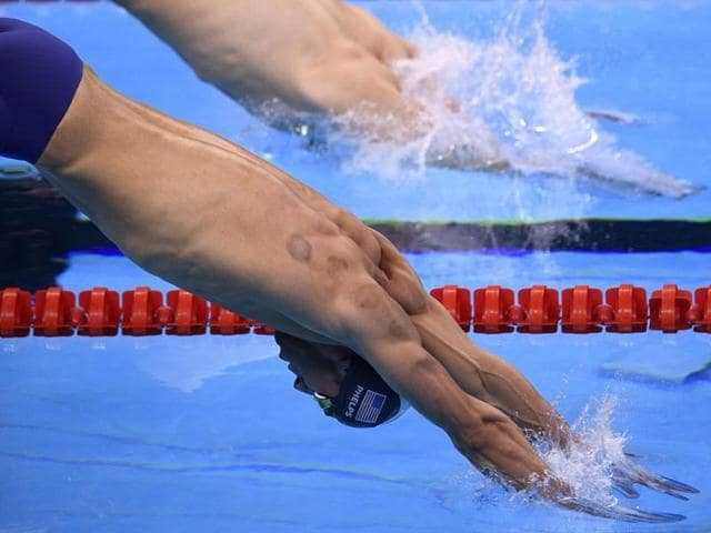 USA's Michael Phelps competes in the Men's 200m Butterfly semi-final during the swimming event at the Rio 2016 Olympic Games at the Olympic Aquatics Stadium in Rio de Janeiro.