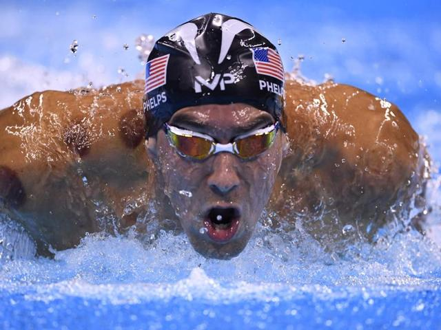 USA's Michael Phelps will set his sights on a record-extending 20th Olympic swimming gold on Tuesday when he tries to wrest back the 200m butterfly title from Chad le Clos.