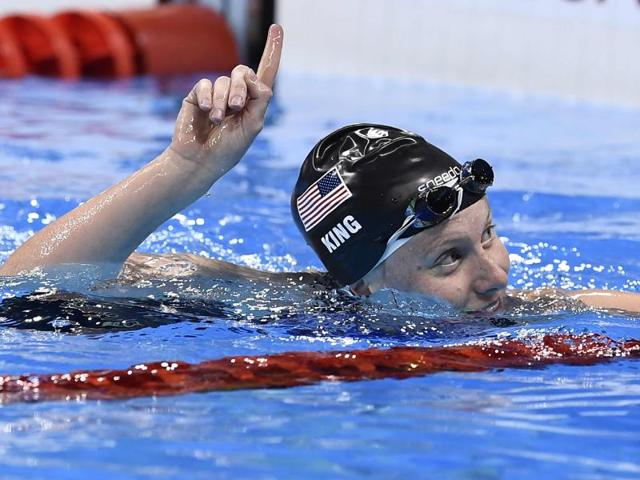 United States' Lilly King, right, and Katie Meili compete in a semifinal of the women's 100m breaststroke.