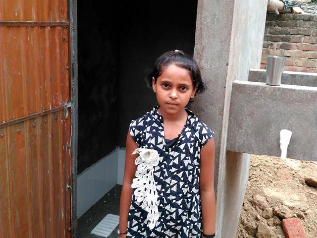 Monica stands outside the toilet she forced her father to construct at their house in Nagla Dileep in Karhal tehsil of UP's Mainpuri district.