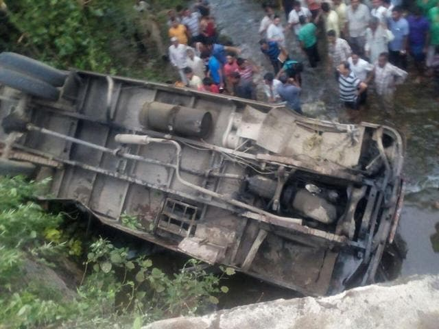 The turned school bus after the accident in Jammu district on Wednesday.