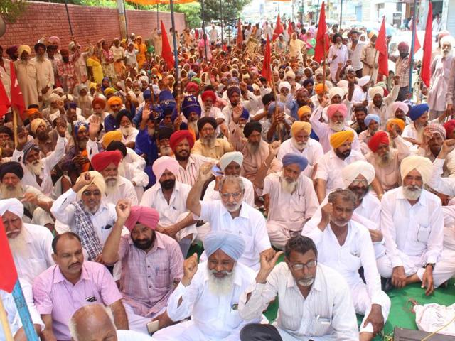 Farmers protesting outside the office of the deputy commissioner in Sangrur on Tuesday.