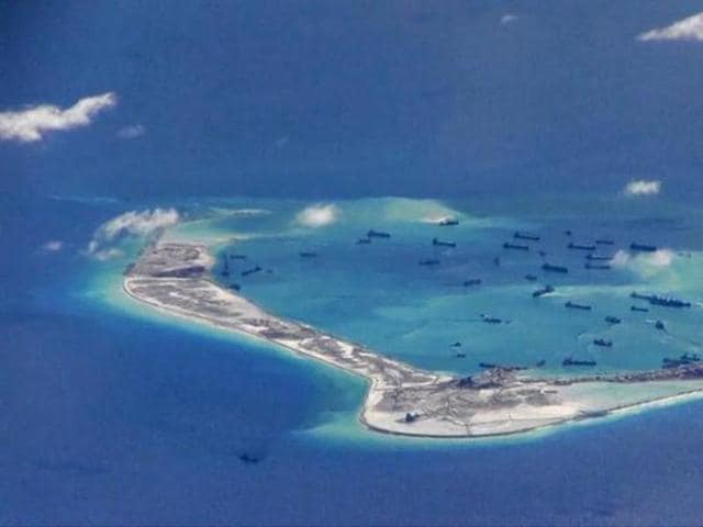 A new satellite photograph shows that China has built aircraft hangars on one of the disputed islands in the South China Sea.