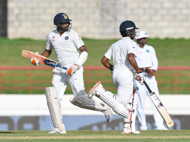R Ashwin (left) and Wriddhiman Saha steadied India with an unbeaten 108-run partnership for the sixth wicket against West Indies on Day I of the third Test.