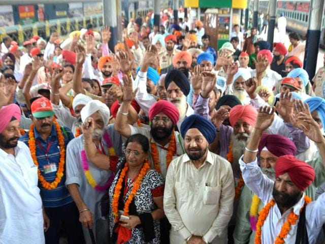 Balwant Singh Ramoowalia along with pilgrims from Uttar Pradesh at the Amritsar railway station on Tuesday.