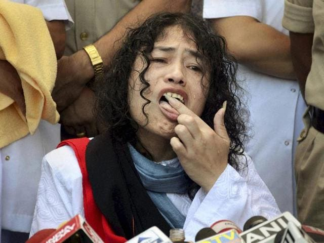 Irom Sharmila licks honey from her hand to break her fast during a press conference in Imphal.