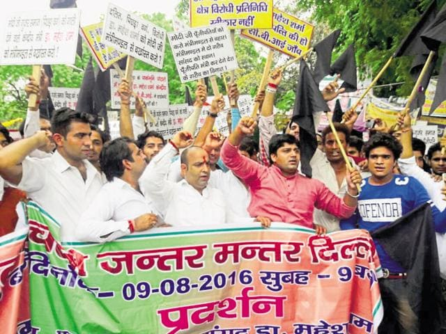 Protesters demand action against culture minister Mahesh Sharma for allegedly making derogatory remarks against the Gurjars.