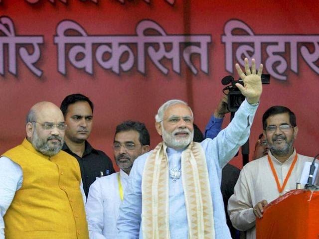 File photo of Prime Minister Narendra Modi with BJP president Amit Shah at Parivartan rally in Gaya, Bihar.