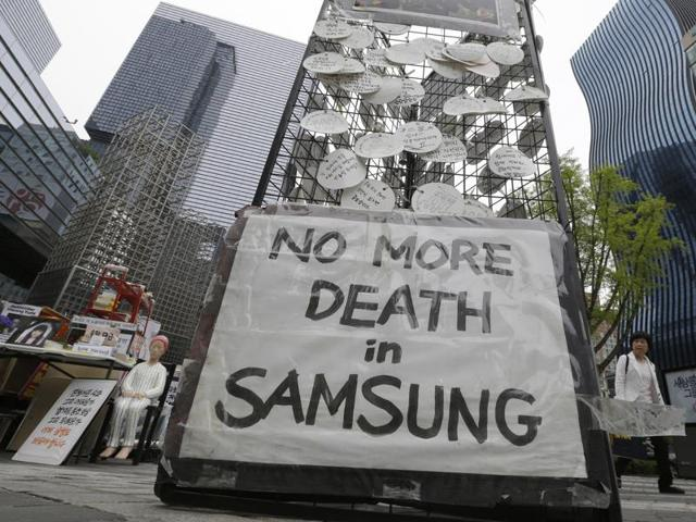 Messages for victims who were former employees at semiconductor factories displayed outside Samsung buildings in Seoul, South Korea.