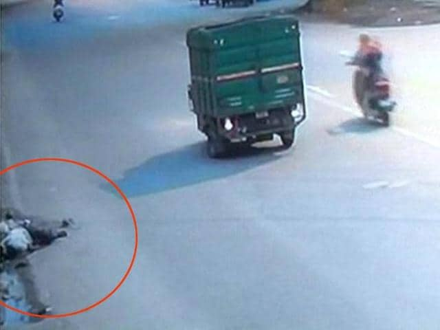 The tempo that hit a man on the road in western Delhi's Subhash Nagar drives off, leaving the victim on the road. The victim bled to death from his injuries.(CCTV grab)