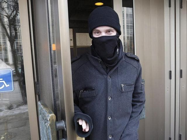 File photo of Aaron Driver leaving a court in Winnipeg in February. A senior police official said on Wednesday a suspect allegedly planning to use a bomb to carry out a suicide bombing in a public area was killed in a police operation. The official, who spoke on condition of anonymity, identified the suspect as Aaron Driver.
